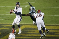 Kony Ealy (94) sacks Peyton Manning (18) for the third time that night