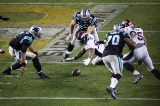 DeMarcus Ware (94) lunges for a fumbled ball as Cam Newton (1) looks on. The fumbled helped squashed what little hope was left of a late Panthers comeback