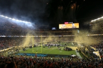 Both teams along with media rush onto the field post game as confetti and fireworks fill the sky. The Denver Broncos are Super Bowl 50 champions