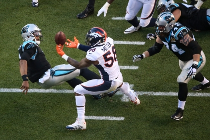 Von Miller (58) sacks Cam Newton (1) and forces the ball free. The Broncos recover the fumble for the first touchdown of the game