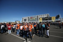 Fans enjoy the sun and pre game festivities in the converted parking lot into fan village